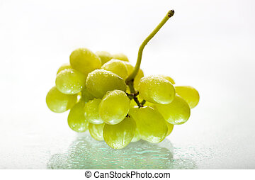Bunch of wet white grapes with reflection