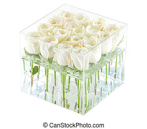 Bunch of white roses in container, with path