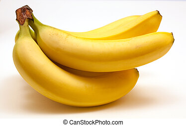 Bunch of whole ripe bananas isolated on a white background