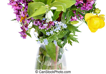 bunch of wild flowers in glass vase