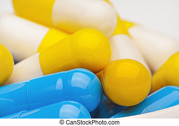 bunch of yellow and blue medical pills