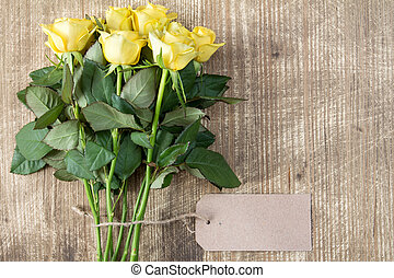 Bunch of yellow roses with blank tag