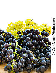 Bunches of fresh white and black seedless grapes