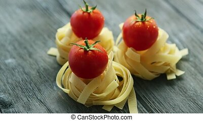 Bunches of pasta with wet tomatoes