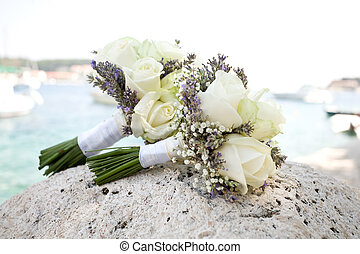 Bunches of roses on a rock