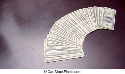 Bundle of American USD Money is on Table