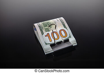 Bundle of dollars on a black background