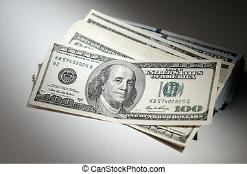 Bundle of dollars on a white table.