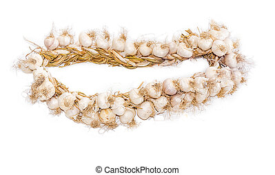 Bundle of garlic on a light background