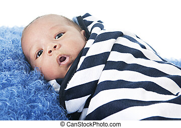 Bundle of Joy - A biracial newborn swaddled in a black and...