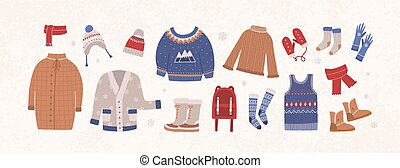 Bundle of knitted winter clothes and outerwear isolated on...