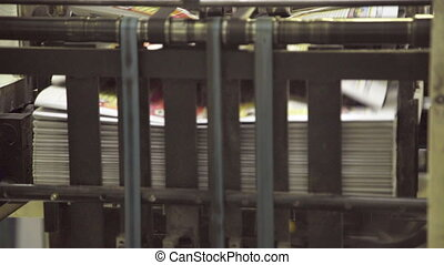 Bundle of newspapers in machine stored paper lot in printing house