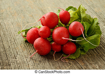 Bundle of radishes on a wooden table