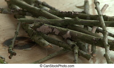Steady, medium close up shot of a bundle of twigs and sticks.