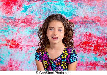 Bunette kid girl portrait smiling in grunge background
