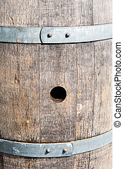 Bung hole in old wood barrel between bands - Bung hole in...