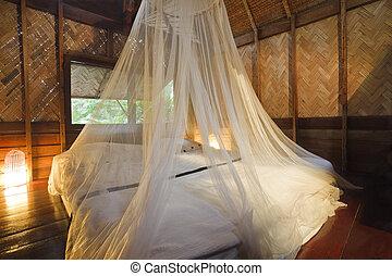 Bungalow bedroom. - Bedroom in a wood bungalow. Horizontal...