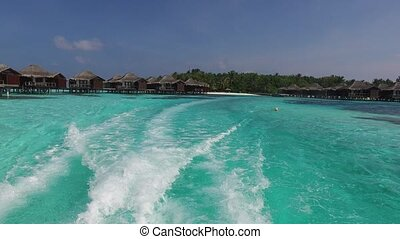 bungalow huts in sea on tropical resort beach - travel,...