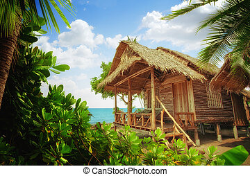 bungalow - view of nice exotic bamboo hut on tropical beach