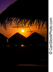 Bungalows at Sunset in Maldives