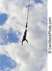 Bungee Jumper with just sky as background.