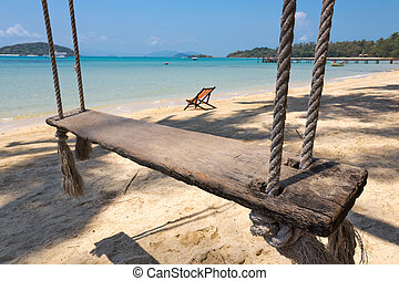 Bungee jumping on the beach of a tropical island
