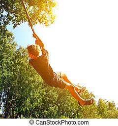 bungee saltando, criança