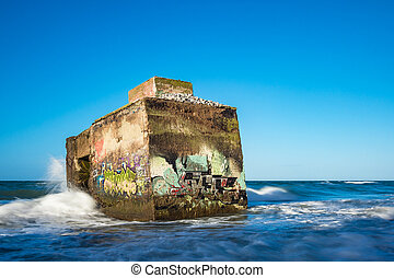 Bunker on shore of the Baltic Sea on a stormy day