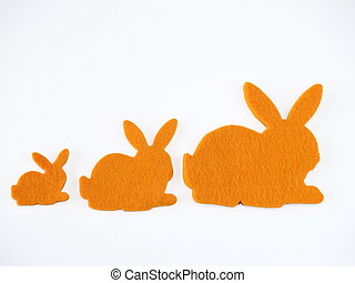 Bunnies shapes made of felt, white background