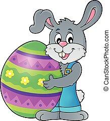 Bunny holding big Easter egg