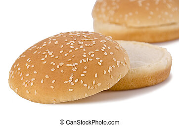 Buns - Hamburger buns with sesame isolated over white...
