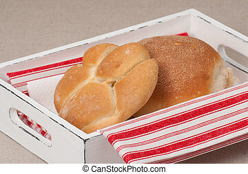 Buns In Tray With Napkin On Natural Linen Background