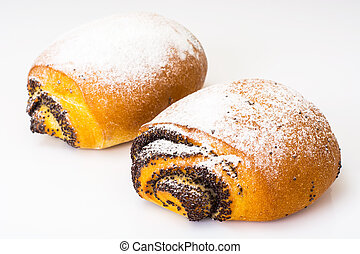 Buns with poppy seeds and icing sugar