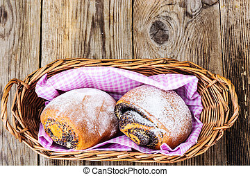 Buns with poppy seeds in a bread basket
