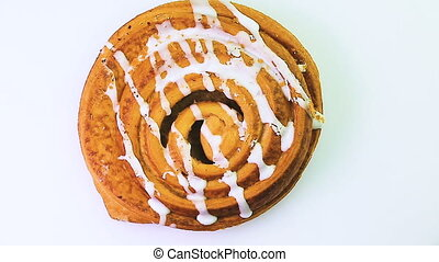 Buns with raisins rotates on a white background. - Buns with...