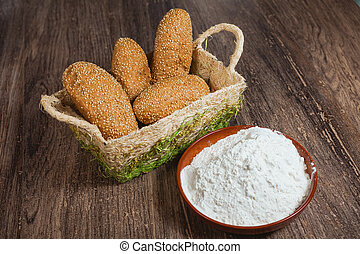 Buns with sesame in a basket