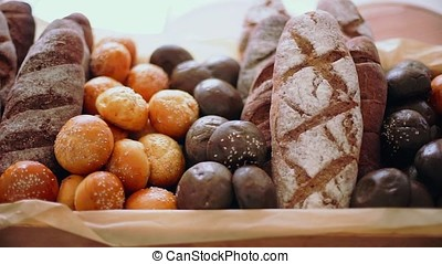 Buns with sesame seeds are in the basket