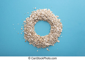 Bunting on a blue background. Oatmeal in the form of a circle.