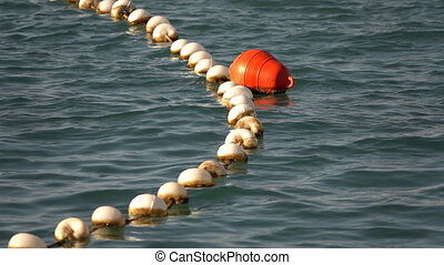 Buoy and Fishnet on Sea Water