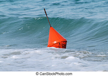 The sea is playing with the orange buoy