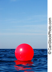 close-up of a red bouy in the ocean