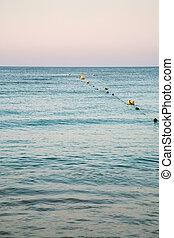 buoys in water on beach near Albufeira