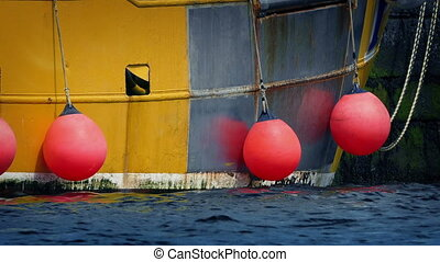 Buoys On Side Of Boat - Red buoys hanging off side of boat...