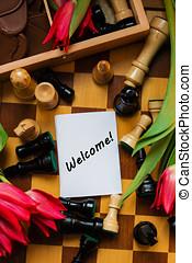 buquet, de, vermelho, tulips, chocolates, em, um, forma, de, um, coração, e, xadrez, com, tag, bem-vindo