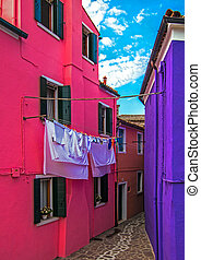 BURANO, ITALY - JUNE 18th, 2018: Detail in Burano, laundry hanging by house
