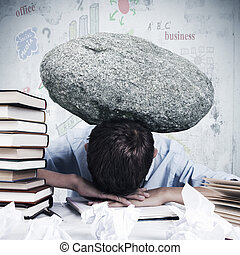 burden in the office - Man at office with stone overhead...