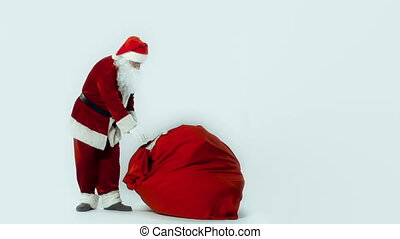 Burden of Choice Is Not Felt - Santa slinging huge sack of...