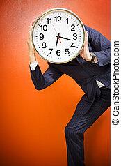 Bureau - Businessman with clock on head, studio shot.