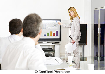 Businesspeople in office. Blond woman having a presentation