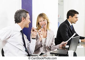 Bureau - Businesspeople talking in meeting room. Businessman...